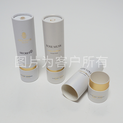 Perfume bottles curling round box